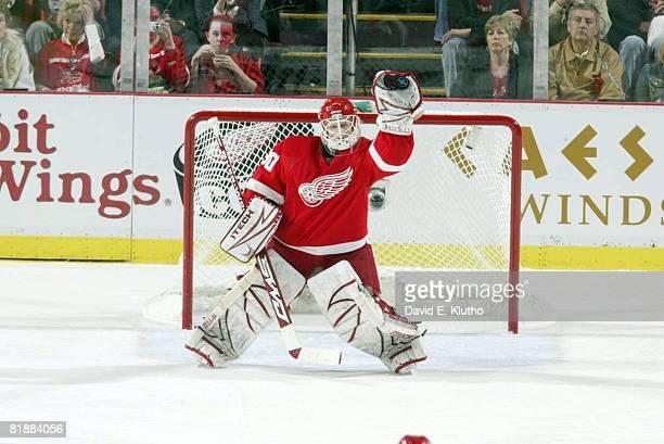 Hockey NHL Playoffs Detroit Red Wings goalie Chris Osgood in action making glove save vs Dallas Stars Game 1 Detroit MI 5/8/2008