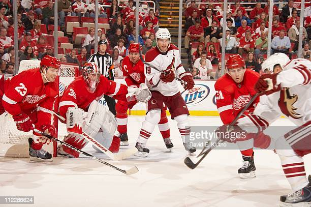 NHL Playoffs Detroit Red Wings goalie Jimmy Howard and Nicklas Lidstrom in action vs Phoenix Coyotes Shane Doan at Joe Louis Arena Game 1Detroit MI...