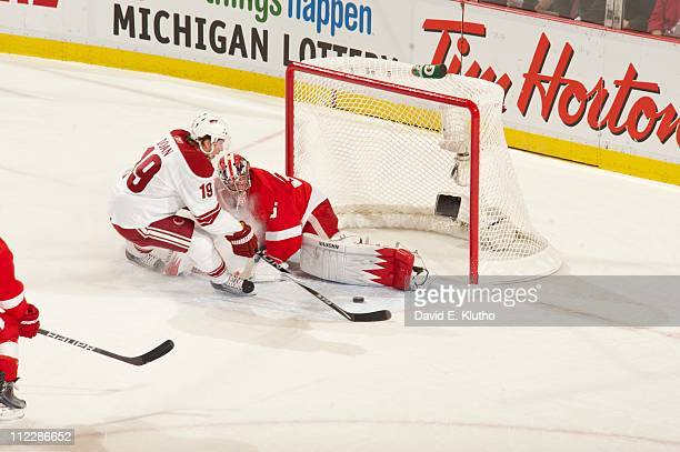 NHL Playoffs Detroit Red Wings goalie Jimmy Howard in action vs Phoenix Coyotes Shane Doan at Joe Louis Arena Game 1Detroit MI 4/13/2011CREDIT David...