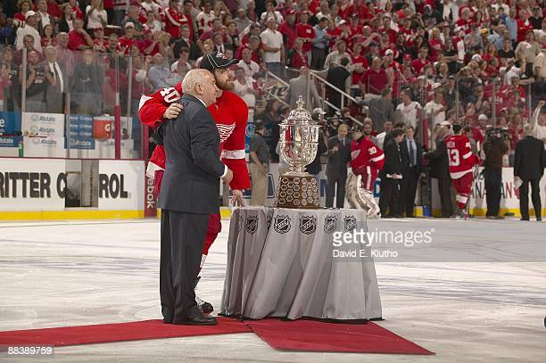 NHL Playoffs Detroit Red Wings Henrik Zetterberg victorious with NHL Vice President Jim Gregory during presentation of Clarence S Campbell Bowl...