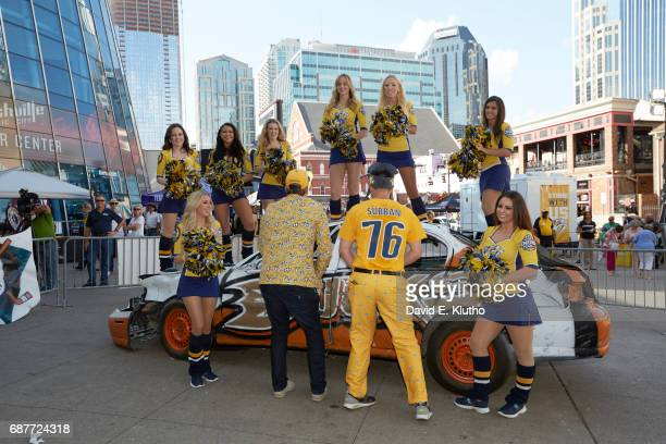 NHL Playoffs Nashville Predators fans outside Bridgestone Arena about to use hammers to destroy car with Anaheim Ducks logo cheerleaders standing on...