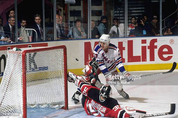 NHL Playoffs New Jersey Devils Martin Brodeur in action making save vs New York Rangers Alexei Kovalev at Madison Square Garden Game 5 New York NY...
