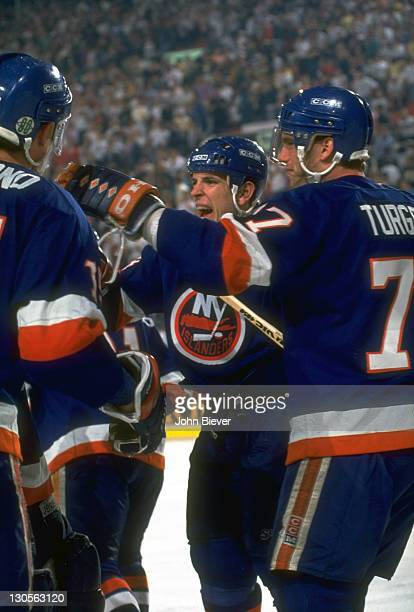 New York Islanders Pierre Turgeon and Tom Fitzgerald victorious after goal vs Pittsburgh Penguins at the Civic Arena. Game 7. David Volek OT goal....