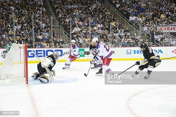 NHL Playoffs New York Rangers Brian Boyle in action scoring goal vs Pittsburgh Penguins goalie MarcAndre Fleury at Consol Energy Center Game 7...