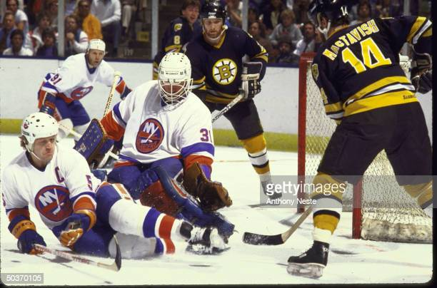 NHL Playoffs NY Islanders Billy Smith in action making save vs Boston Bruins