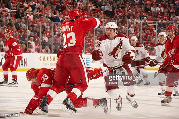 NHL Playoffs Phoenix Coyotes Shane Doan in action vs Detroit Red Wings Kris Draper and Brad Stuart at Joe Louis Arena Game 2Detroit MI...