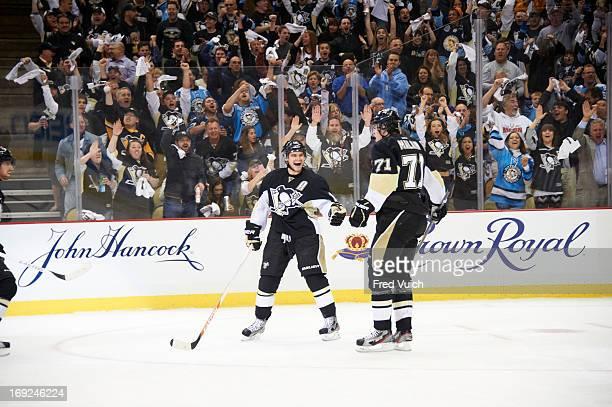 NHL Playoffs Pittsburgh Penguins Chris Kunitz and Evgeni Malkin victorious after goal vs Ottawa Senators at CONSOL Energy Center Game 1 Pittsburgh PA...