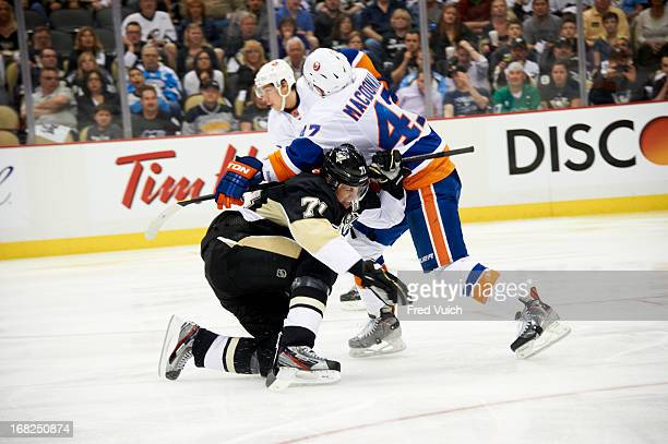 NHL Playoffs Pittsburgh Penguins Evgeni Malkin in action vs New York Islanders Andrew MacDonald at Consol Energy Center Game 1 Pittsburgh PA CREDIT...