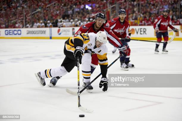 NHL Playoffs Pittsburgh Penguins Evgeni Malkin in action vs Washington Capitals John Carlson at Verizon Center Game 5 Washington DC CREDIT Al...