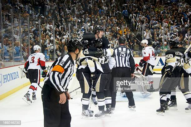 NHL Playoffs Pittsburgh Penguins Sidney Crosby 87 Chris Kunitz and Evgeni Malkin victorious after goal vs Ottawa Senators at CONSOL Energy Center...