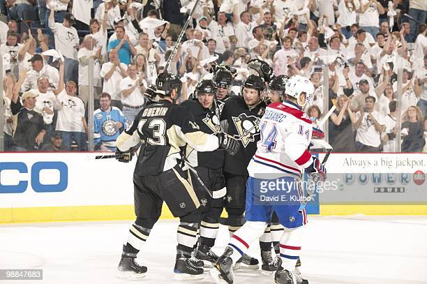 NHL Playoffs Pittsburgh Penguins Sidney Crosby Bill Guerin Evgeni Malkin and Sergei Gonchar victorious celebration after goal during Game 1 vs...