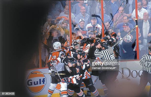Hockey NHL Playoffs Referee Brad Lazarowich attempting to break up fight between Philadelphia Flyers Keith Jones John LeClair and Buffalo Sabres...