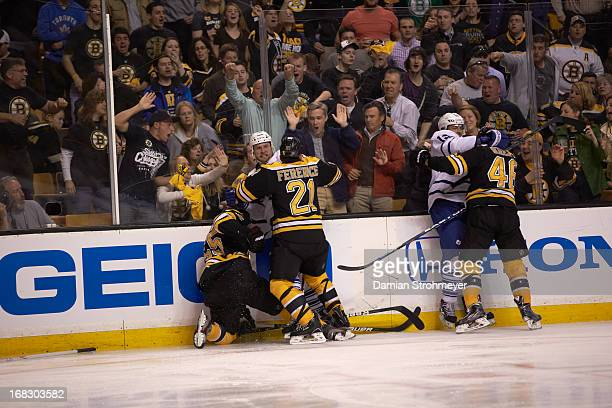 NHL Playoffs Toronto Maple Leafs Colton Orr during fight vs Boston Bruins Andrew Ference and Johnny Boychuk at TD Garden Game 1 Boston MA CREDIT...
