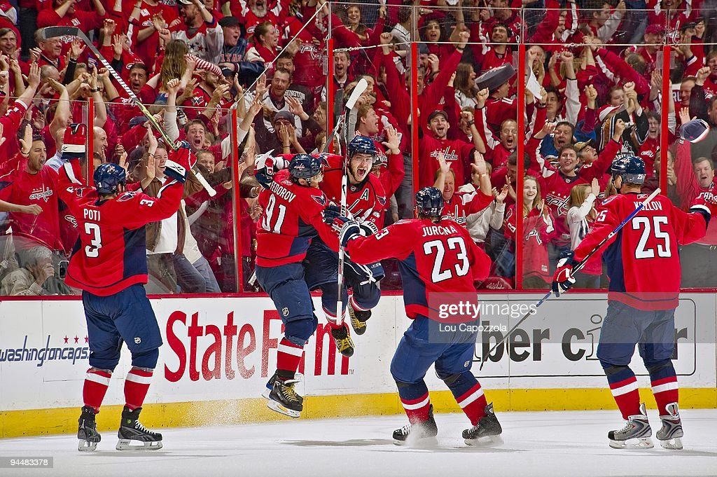 Washington Capitals Alex Ovechkin victorious with Sergei Fedorov ... 2f19d531f83