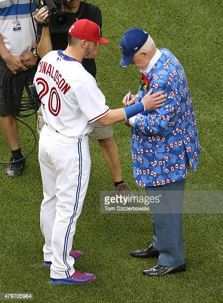 Hockey personality Don Cherry is greeted by Josh Donaldson of the Toronto Blue Jays after throwing out the ceremonial first pitch on Canada Day...