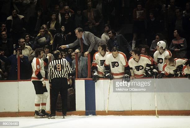 Philadelphia Flyers coach Fred Shero pointing at Dave Schultz during game vs Minnesota North Stars Philadelphia PA 3/28/1973 CREDIT Melchior DiGiacomo