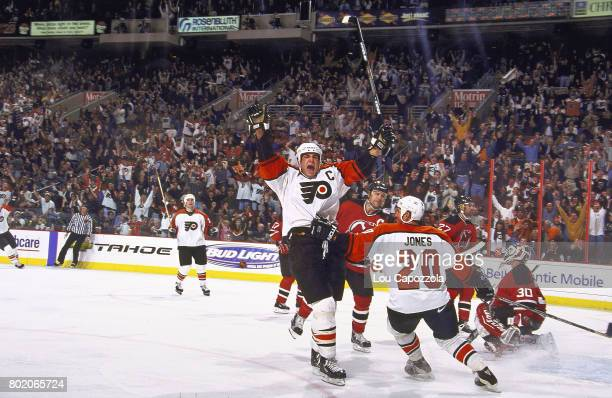 Philadelphia Flyers Eric Lindros victorious with teammates on ice after scoring goal vs New Jersey Devils at First Union Center Philadelphia PA...