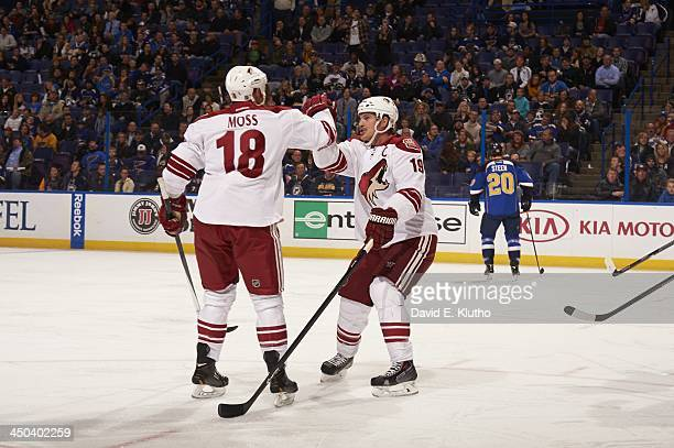 Phoenix Coyotes David Moss and Shane Doan victorious during game vs St. Louis Blues at Scottrade Center. St. Louis, MO CREDIT: David E. Klutho
