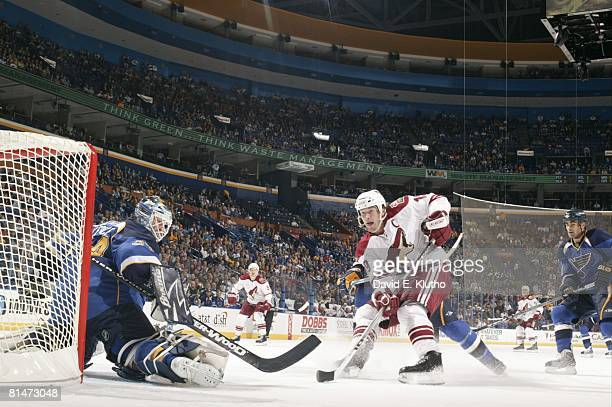 Hockey Phoenix Coyotes Shane Doan in action taking shot vs St Louis Blues goalie Manny Legace St Louis MO