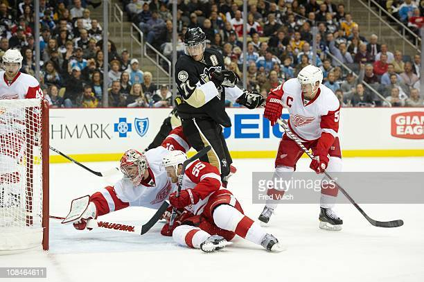 Pittsburgh Penguins Evgeni Malkin in action vs Detroit Red Wings goalie Joey MacDonald Niklas Kronwall and Nicklas Lidstrom at Consol Energy Center...