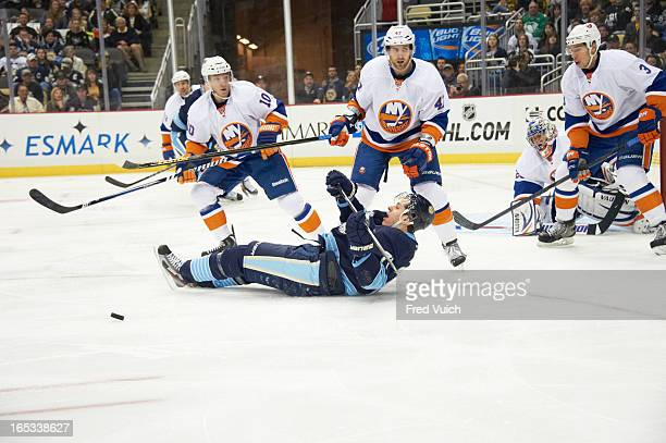 Pittsburgh Penguins Evgeni Malkin in action vs New York Islanders Andrew McDonald and Keith Aucoin at Consol Energy Center Pittsburgh PA CREDIT Fred...