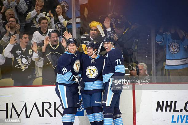 Pittsburgh Penguins James Neal victorious after scoring goal with Matt Niskanen and Evgeni Malkin vs New York Islanders at Consol Energy Center...