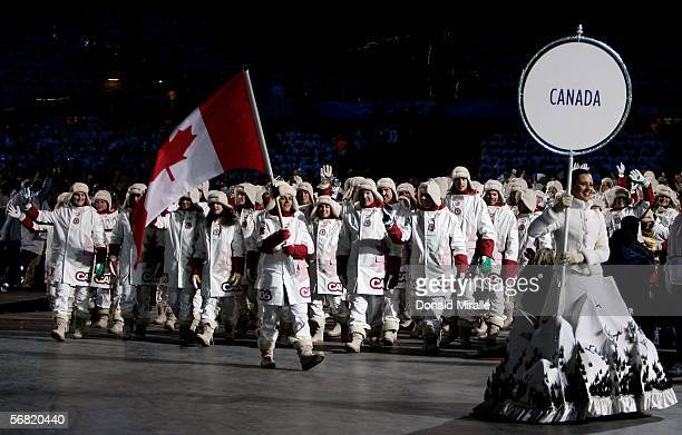 Hockey player Danielle Goyette carries the Canadian flag during the Opening Ceremony of the Turin 2006 Winter Olympic Games on February 10, 2006 at...