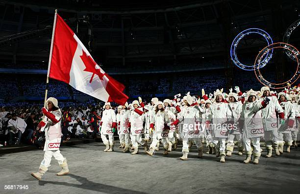 Hockey player Danielle Goyette carries the Canadian flag in front of her teammates during the Opening Ceremony of the Turin 2006 Winter Olympic Games...