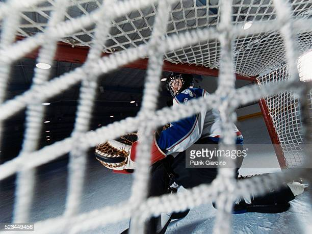 hockey player defending goal - ice hockey player stock pictures, royalty-free photos & images