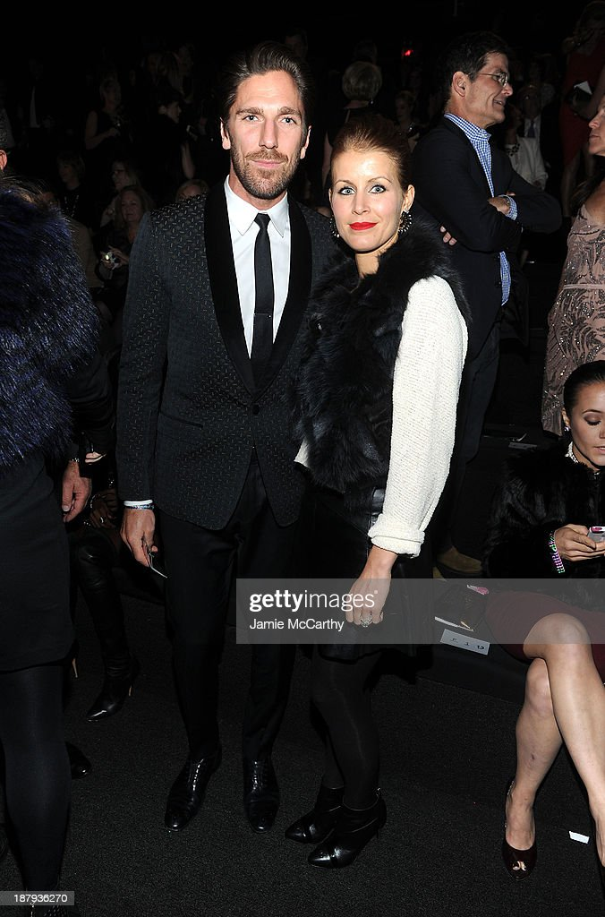 Hockey player Henrik Lundqvist (L) and Therese Andersson attends the 2013 Victoria's Secret Fashion Show at Lexington Avenue Armory on November 13, 2013 in New York City.