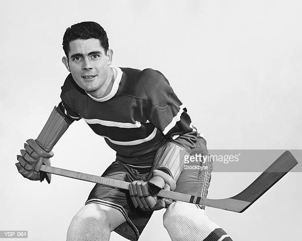 Hockey player holding stick