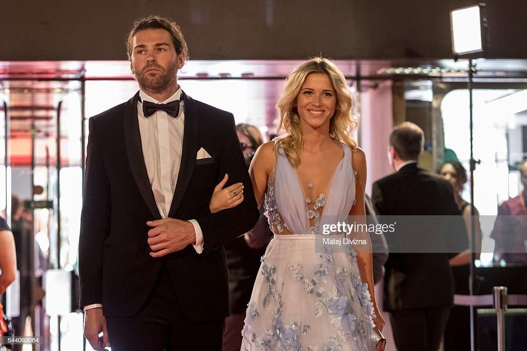 Hockey player Jaromir Jagr and his girlfriend Veronika Koprivova arrive at the opening ceremony of the 51st Karlovy Vary International Film Festival (KVIFF) on July 1, 2016 in Karlovy Vary, Czech Republic.