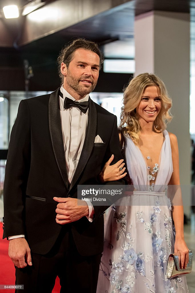 Hockey player Jaromir Jagr and his girlfriend Veronika Koprivova pose for photographers as they arrive at the opening ceremony of the 51st Karlovy Vary International Film Festival (KVIFF) on July 1, 2016 in Karlovy Vary, Czech Republic.