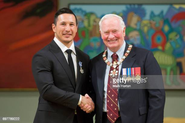 NHL hockey player Jordin Tootoo is awarded the Meritorious Service Medal by Governor General of Canada David Johnston at Rideau Hall on June 19 2017...