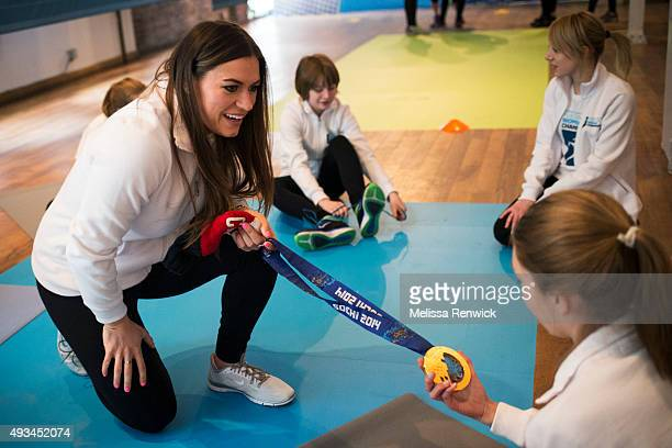 Hockey player Natalie Spooner shows off her Olympic gold medal to young athletes at the Fuelling Women Champions event at The Glass Factory Banning...