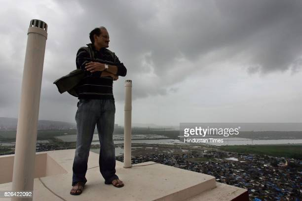 Hockey Player Niranjan Negi takes in a birds eye view of the city from his terrace in the early morning on the eve of the launch of the film Chak De...