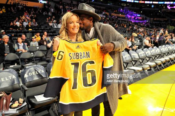 Hockey player P K Subban presents his jersey to Jeanie Buss before the basketball game between the Los Angeles Lakers and the Memphis Grizzlies at...