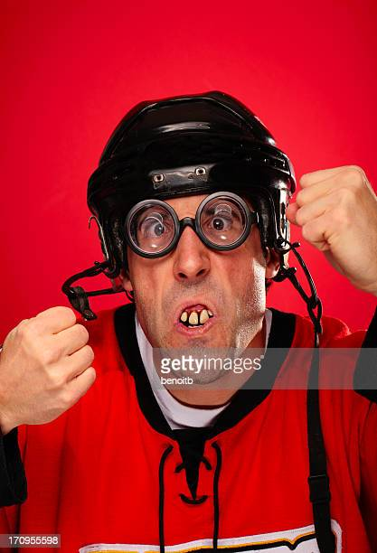 hockey player ready to fight - bad teeth stock photos and pictures