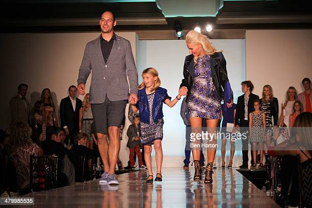 Hockey player Ryan Getzlaf, Audrey Sugden, and Paige Getzlaf attend the Anaheim Lady Ducks Fashion Show Luncheon with Bloomingdale's South Coast...