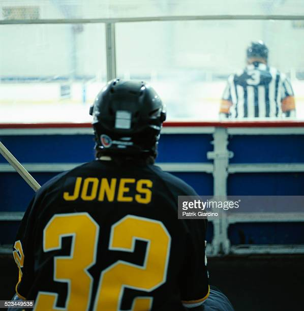 hockey player sitting in penalty box - ice hockey uniform stock pictures, royalty-free photos & images