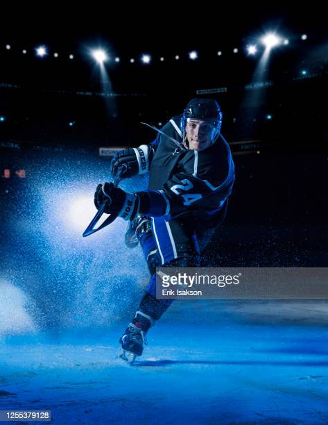 hockey player striking - hockey player stock pictures, royalty-free photos & images