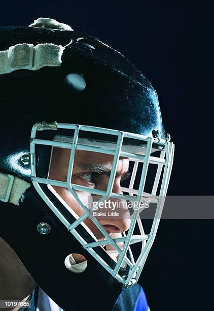 Hockey player wearing helmet, close-up