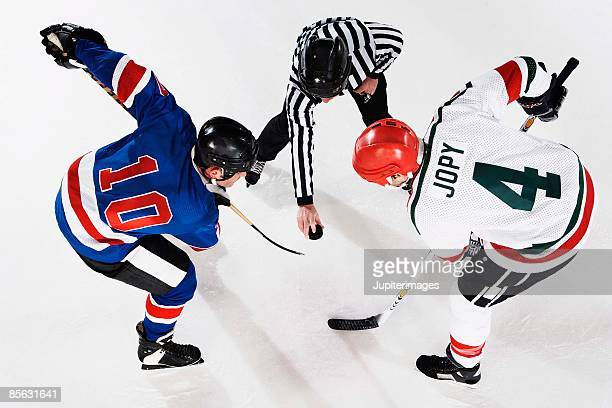 hockey players at face off - ice hockey uniform stock pictures, royalty-free photos & images