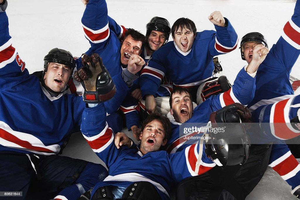 Hockey players celebrating : Stock Photo