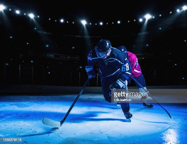 hockey players during match - hockey player stock pictures, royalty-free photos & images