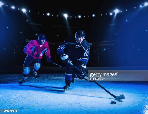 hockey players during match - ice hockey uniform stock pictures, royalty-free photos & images