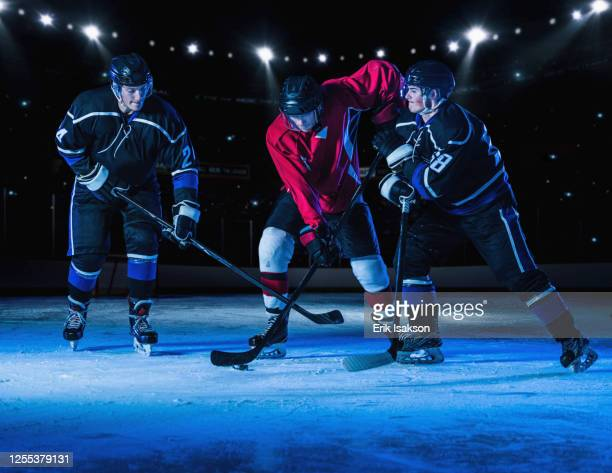 hockey players fighting for puck - ice hockey uniform stock pictures, royalty-free photos & images