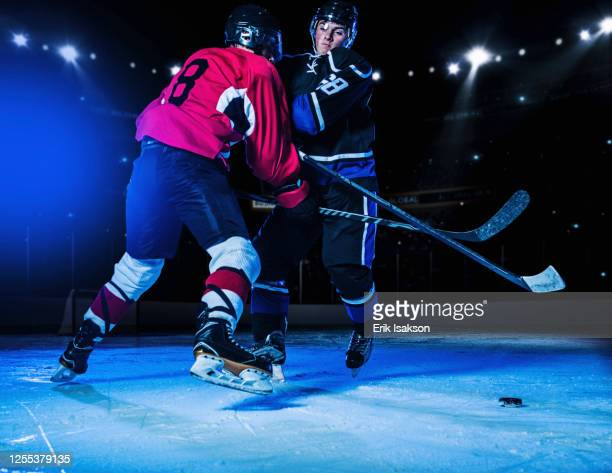 hockey players fighting for puck - winter sport stock pictures, royalty-free photos & images