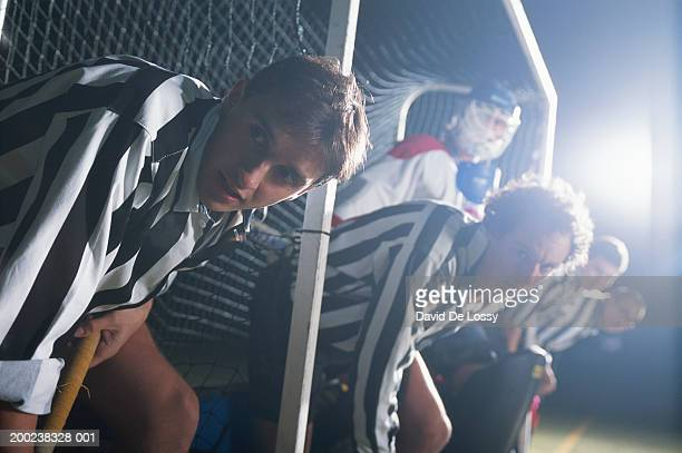 Hockey players in a row, low angle view