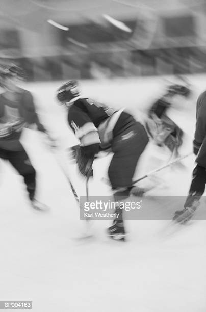 hockey players in action - ice hockey uniform stock pictures, royalty-free photos & images